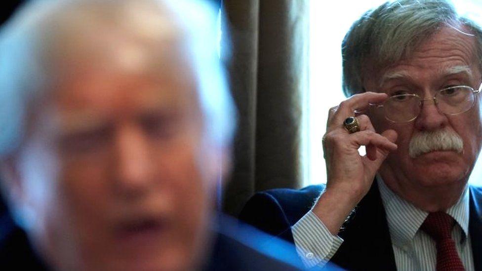 John Bolton (R) and Donald Trump