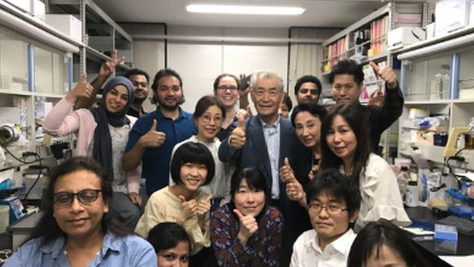 Tasuku Honjo and his team