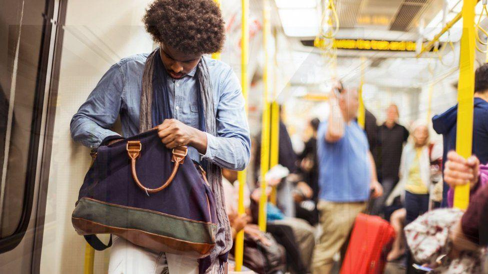 Man looking in bag