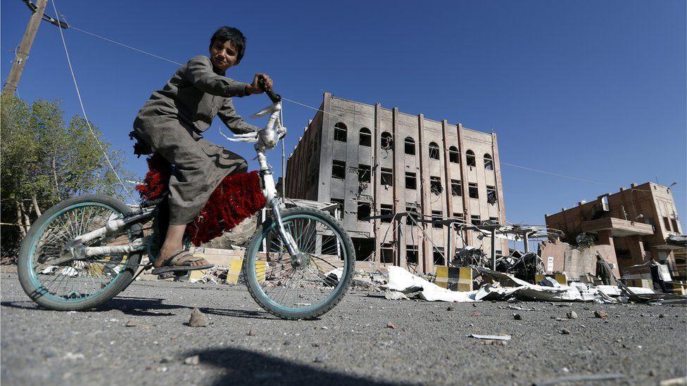 Child on bike in Yemen