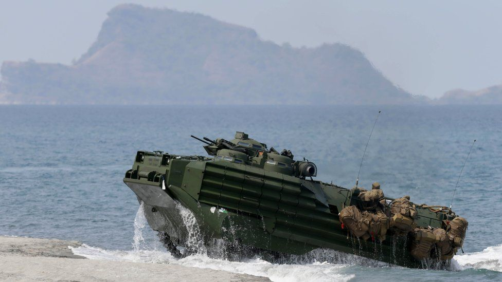 File photo: A US amphibious assault vehicle with Philippine and US troops on board storms the beach at a combined assault exercise at a beach facing one of the contested islands in the South China Sea known as the Scarborough Shoal in the West Philippine Sea, 21 April 2015