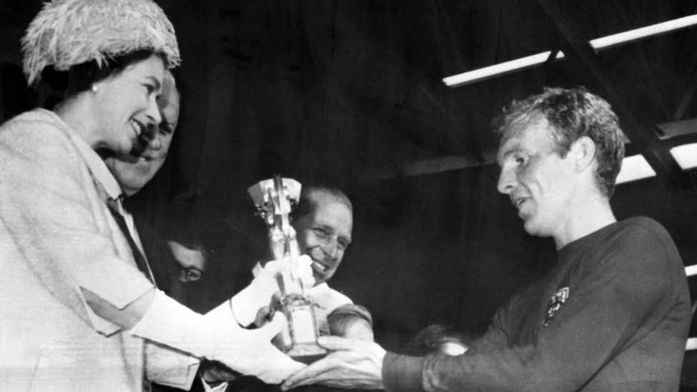 The Queen presents Bobby Moore with the Jules Rimet Trophy for winning the World Cup in 1966