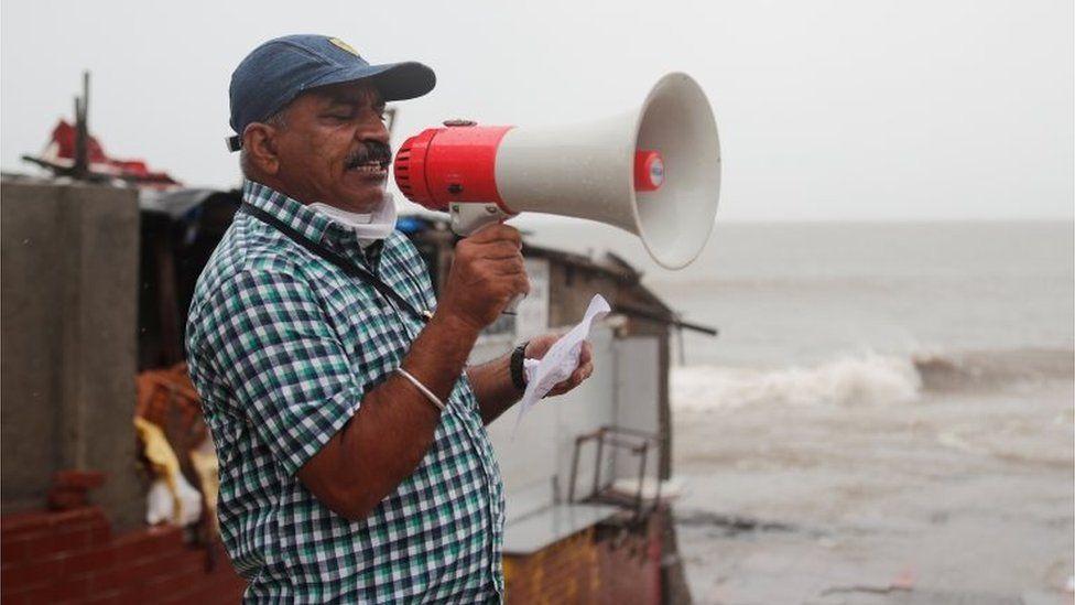 A Brihanmumbai Municipal Corporation (BMC) official makes an announcement to stay indoors over a loudspeaker before cyclone Nisarga makes its landfall, in Mumbai, India June 3, 2020.