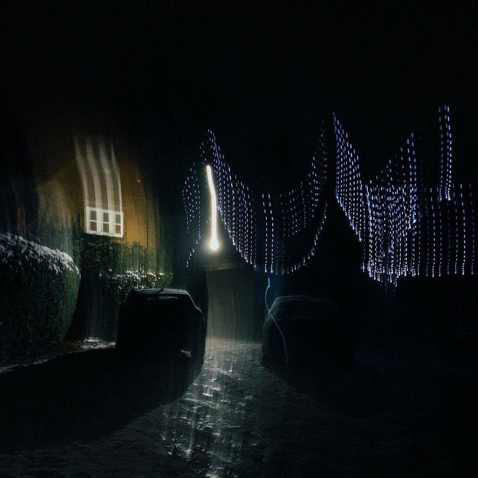 A blurry image of Christmas lights on a house