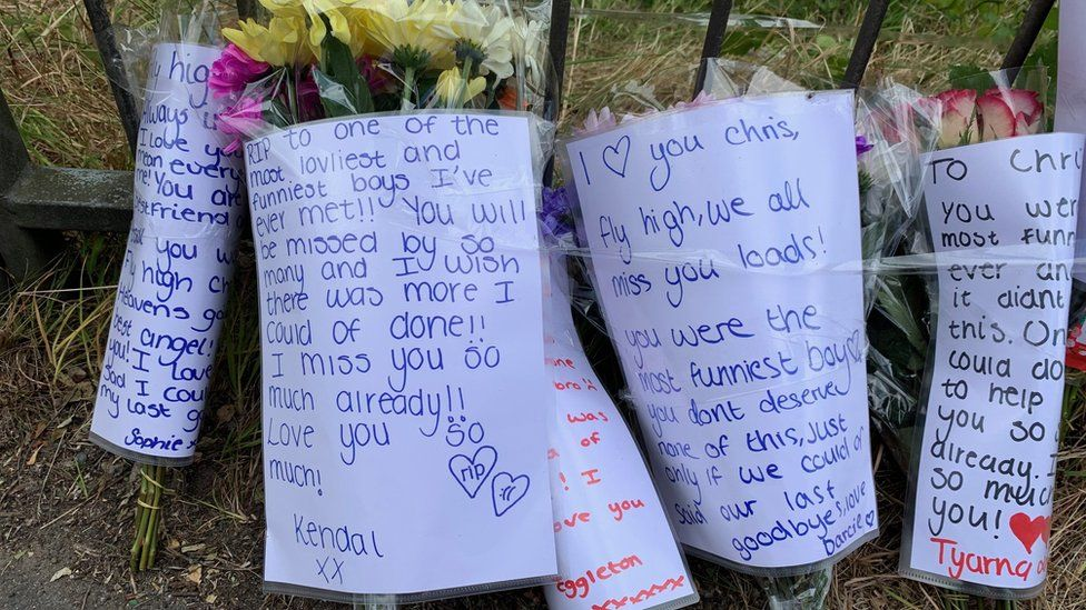 Written tributes at the scene
