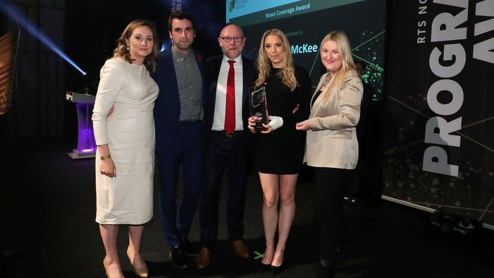 The BBC News team pictured with their award at the ceremony in Belfast's MAC