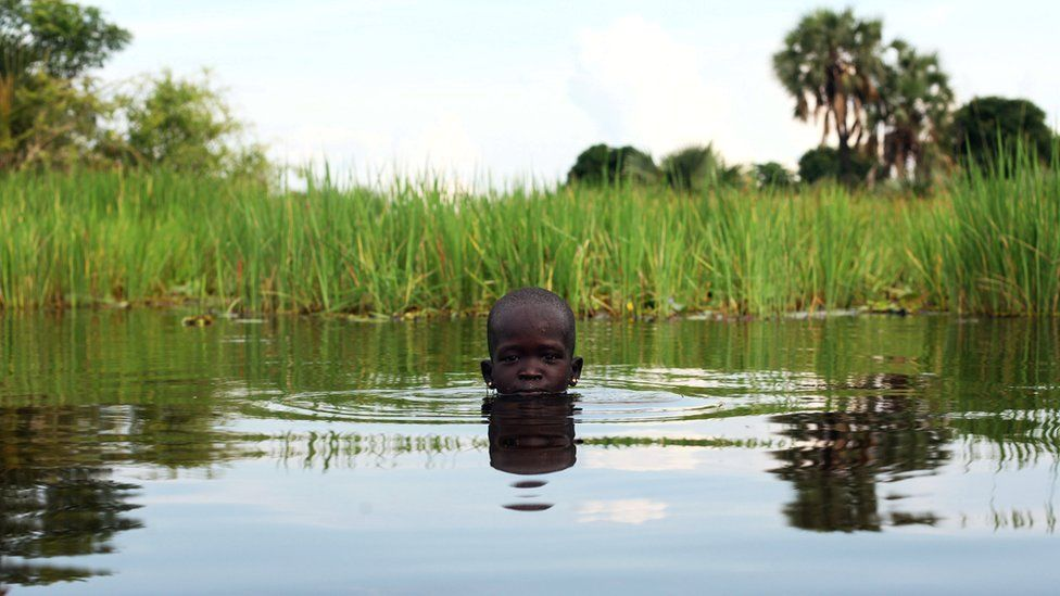 A displaced girl plays in the Sudd Swamp near the town of Nyal, South Sudan - Sunday 19 August 2018