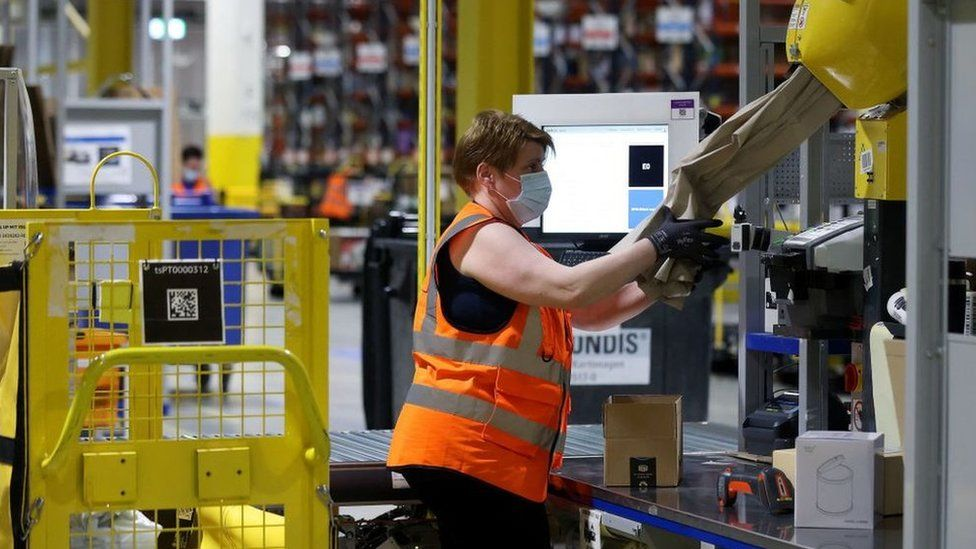 Worker in an Amazon warehouse.