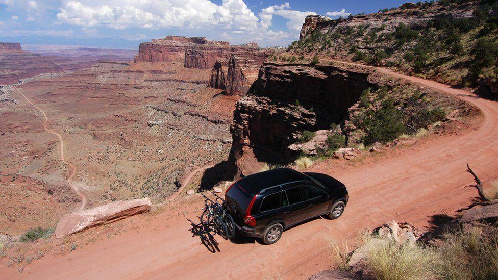 SUV driving along Grand Canyon road