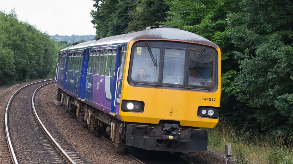 Pacer train on the mainline approaching Deighton station near Huddersfield, West Yorkshire