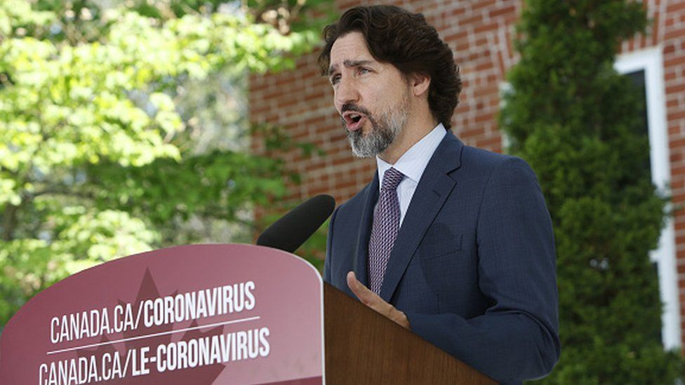 Justin Trudeau speaks during a news conference outside Rideau Cottage in Ottawa, Ontario
