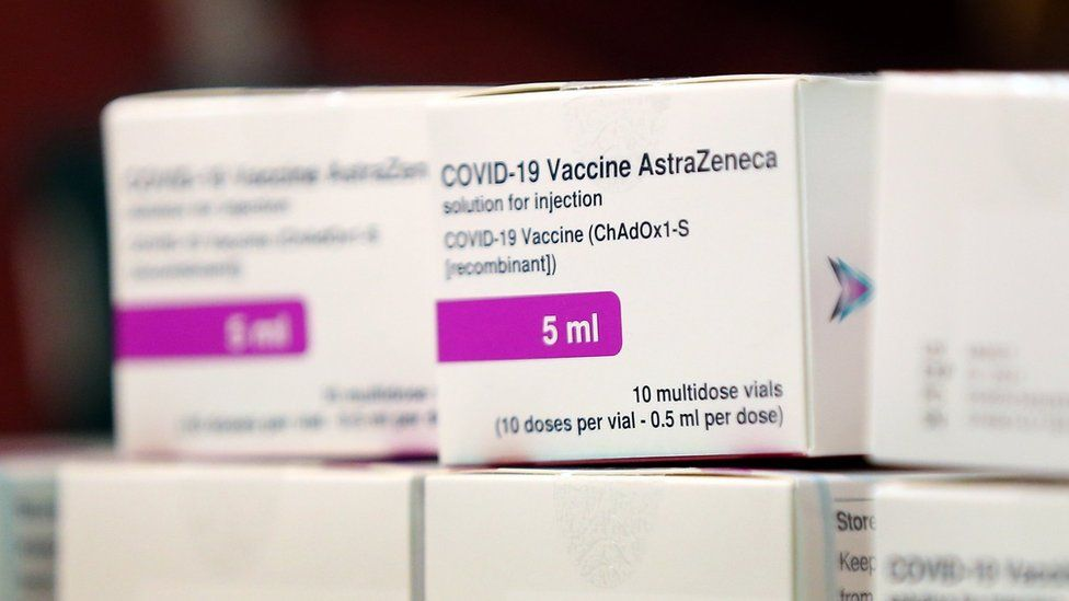 Doses of the Oxford University/AstraZeneca Covid-19 vaccine is checked