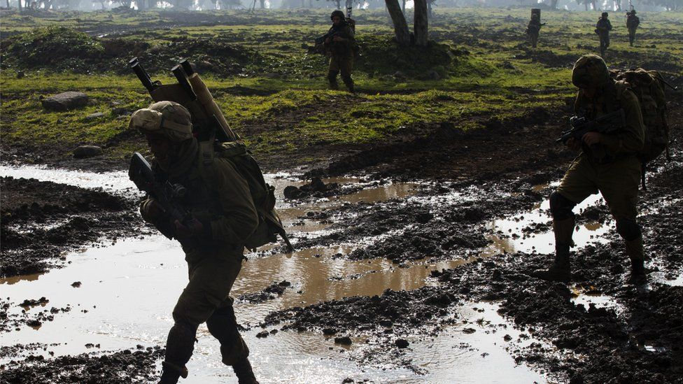 Israeli soldiers from the Golani Brigade take part in a military training exercise in the Israeli-annexed Golan Heights near the border with Syria on 19 January 2015.