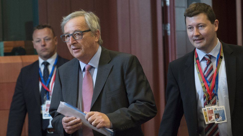 EU Commission President Jean Claude Juncker (C) arrives with his Chief of Cabinet Martin Selmayr (R), June 11, 2015