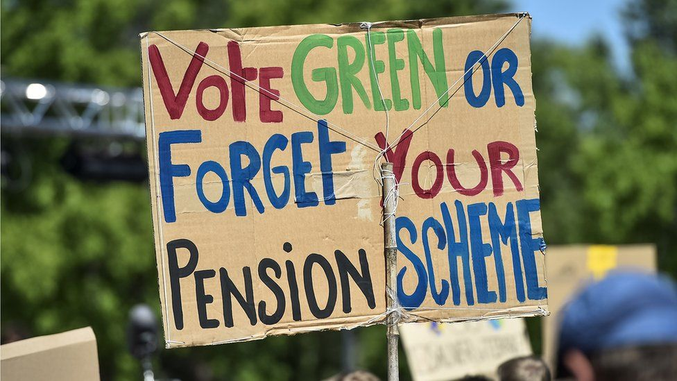 Sign saying 'Vote green or forget your pension scheme'