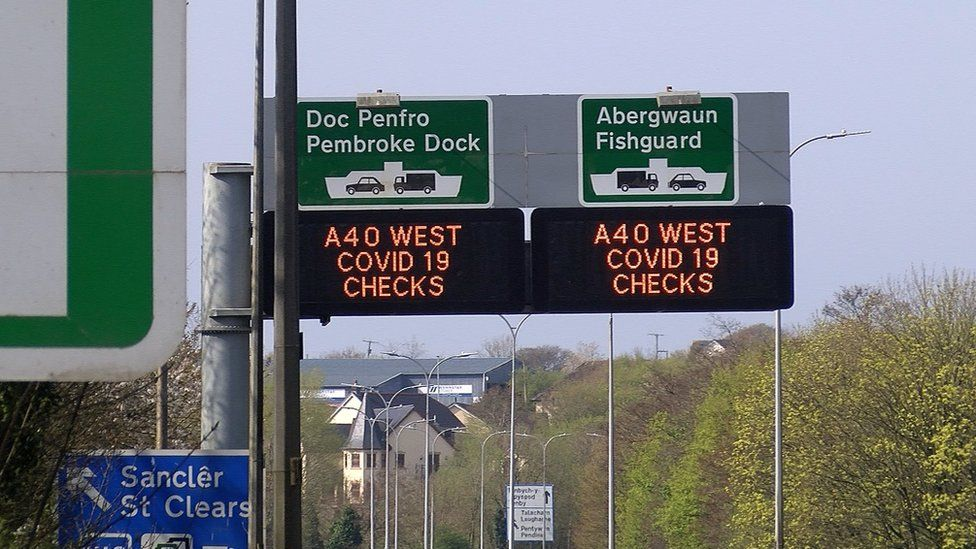 Signs on the A40 alerting drivers to Covid-19 checks