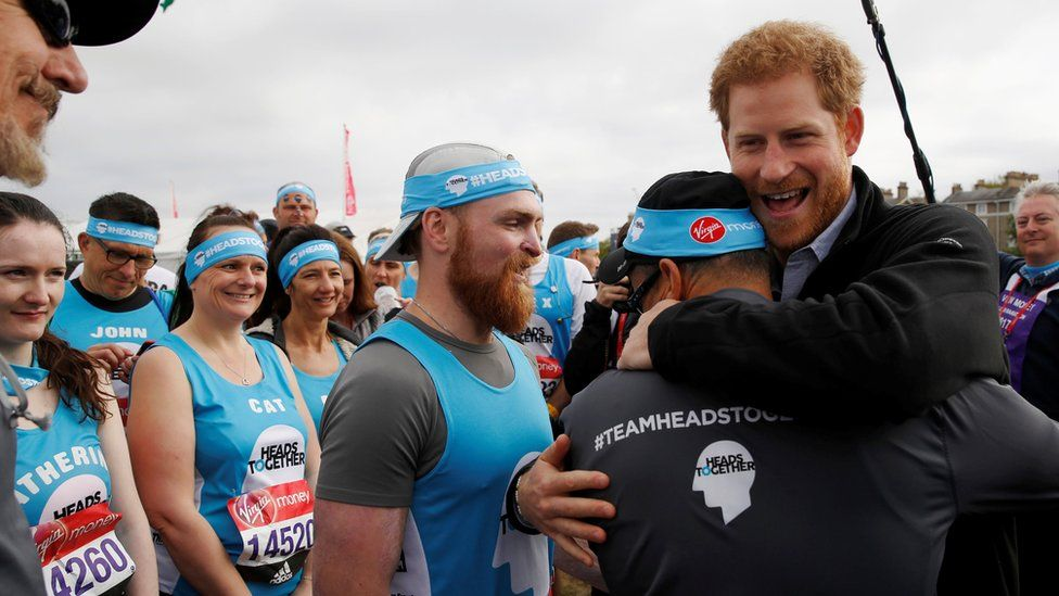 Prince Harry greets runners from the Head Together charity