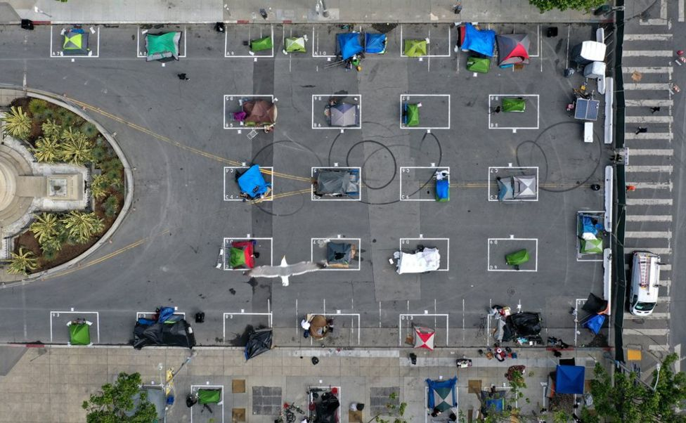 An aerial view showing tents set up in individually marked spaces on the ground