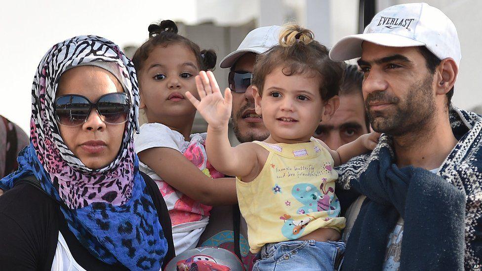 Migrants disembark from the Italian Coast Guard ship Fiorillo in the harbour of Pozzallo, near Ragusa, Sicily, Italy (7 August 2015)