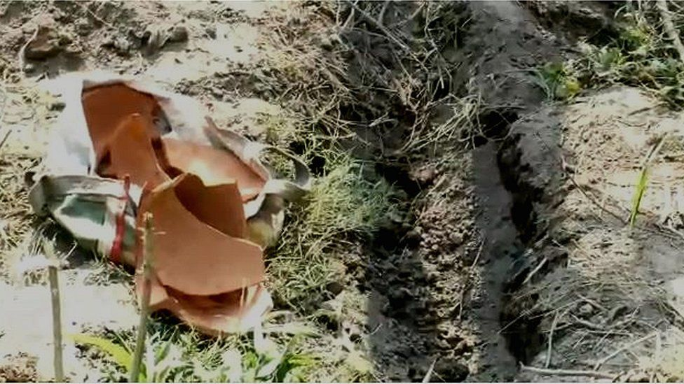 The broken pot in which the baby was buried