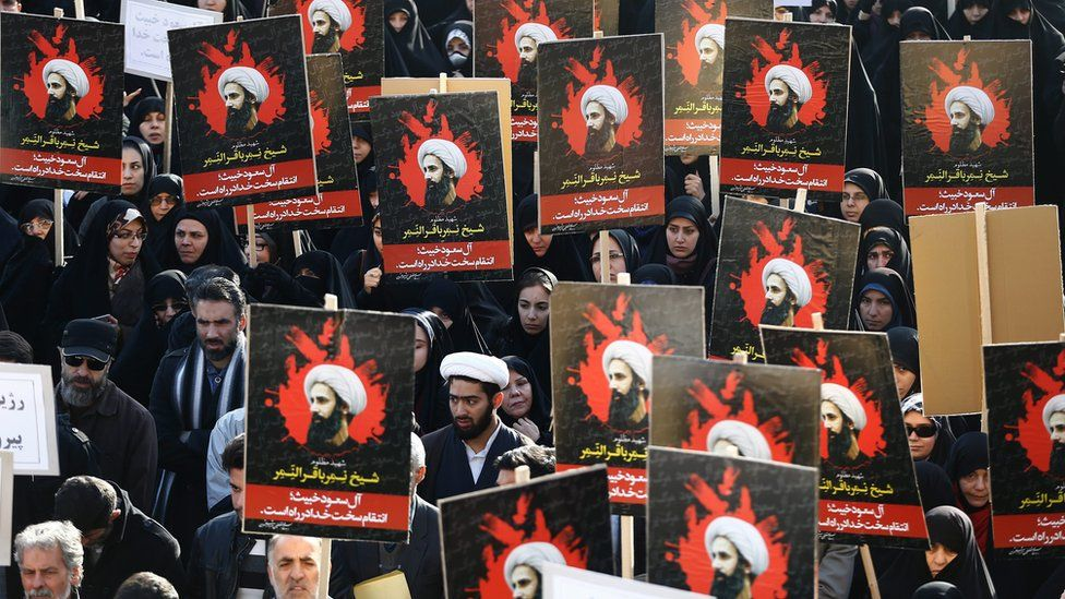 Iranians hold posters of Shia cleric Nimr al-Nimr at a protest in Tehran following his execution by Saudi Arabia (4 January 2016)