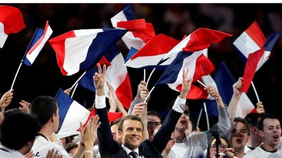Emmanuel Macron (centre) campaigns in Paris. Photo: 17 April 2017