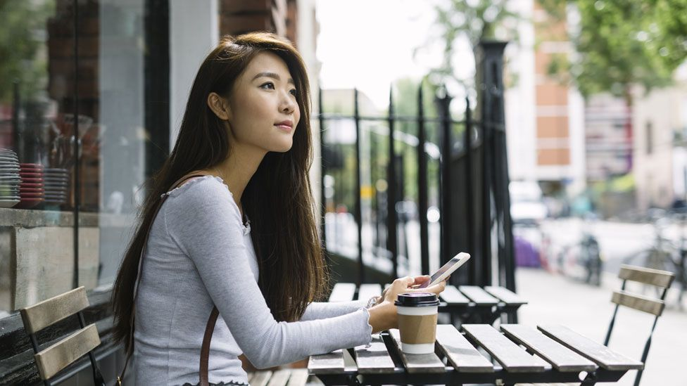 A woman using a smartphone (stock image)