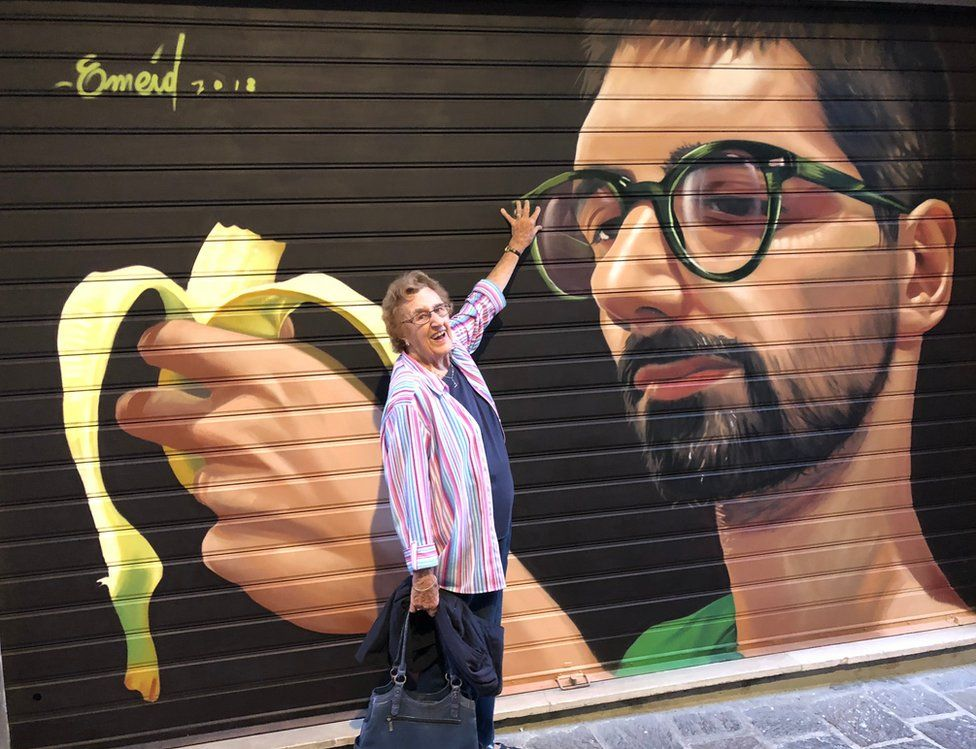 A woman and street art