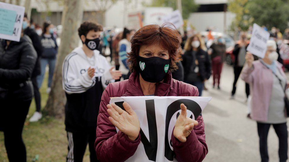 A demonstrator attends a protest against the regional government's measures to control the spread of the coronavirus disease (COVID-19), at Vallecas neighbourhood in Madrid, Spain, October 4, 2020.