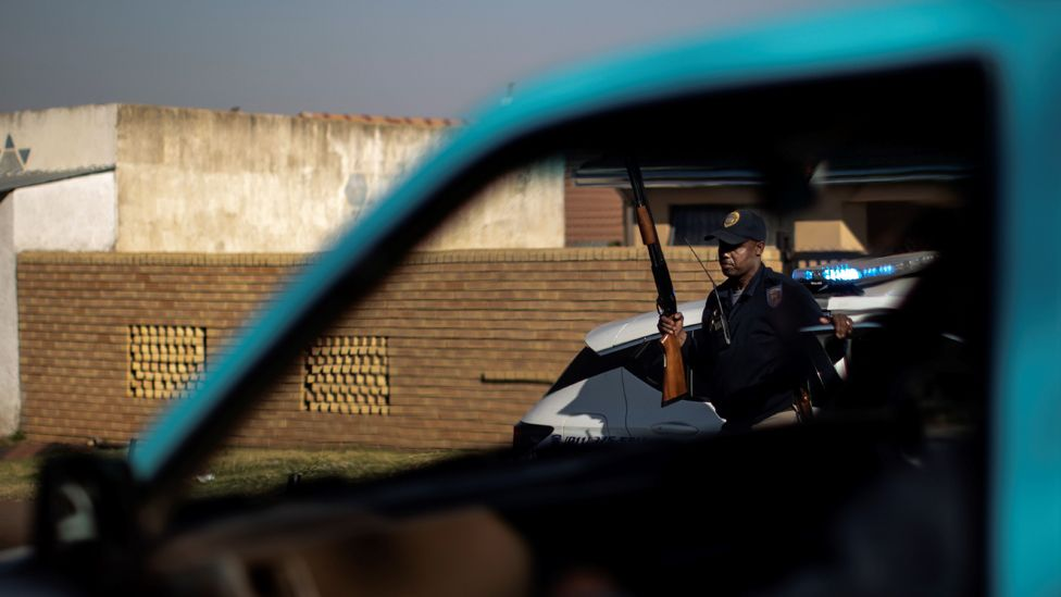 A police officer carrying a rifle in Soweto, in Johannesburg.
