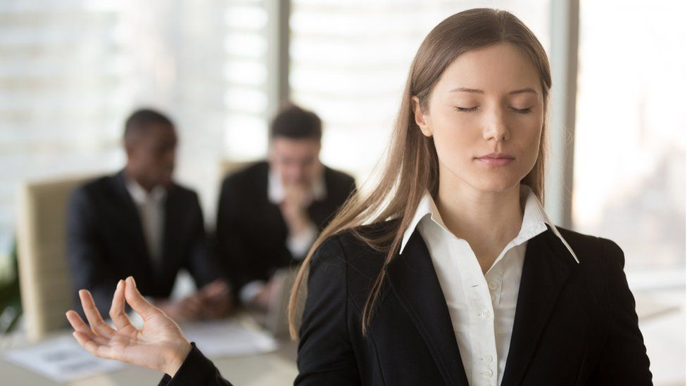 Woman trying to keep calm in office after interview