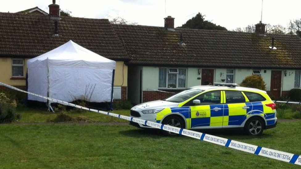 Bungalow, police tent, cordon and police car