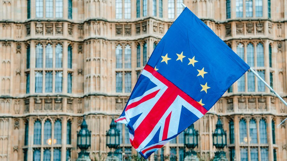 British/EU flag hanging outside the Palace of Westminster
