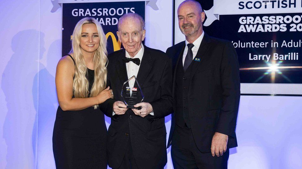 Larry Barilli, pictured with his award along with former Scotland Women's international Suzanne Winters and Scotland manager Steve Clarke.