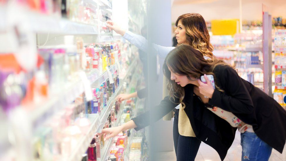 Women shopping for perfume