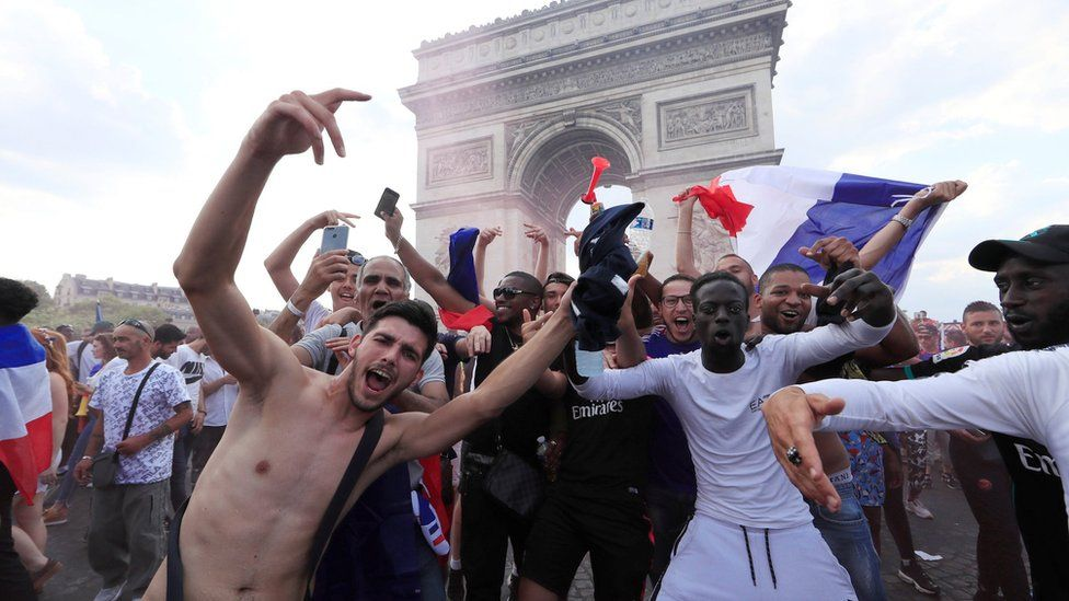 France fans react on the Champs-Elysees avenue after they defeated Croatia during their Soccer World Cup final match