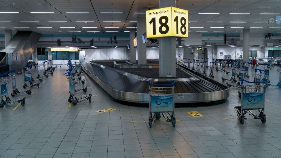 An empty baggage reclaim area at Schiphol International Airport in Amsterdam