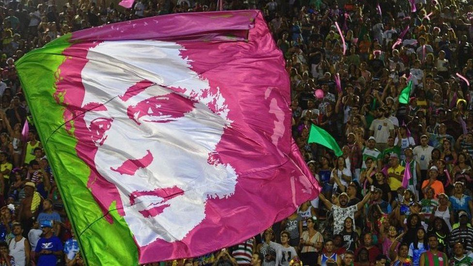 A flag depicting the image of murdered councillor Marielle Franco is seen during the second night of Rio's Carnival parade at the Sambadrome in Rio de Janeiro, on March 5, 2019