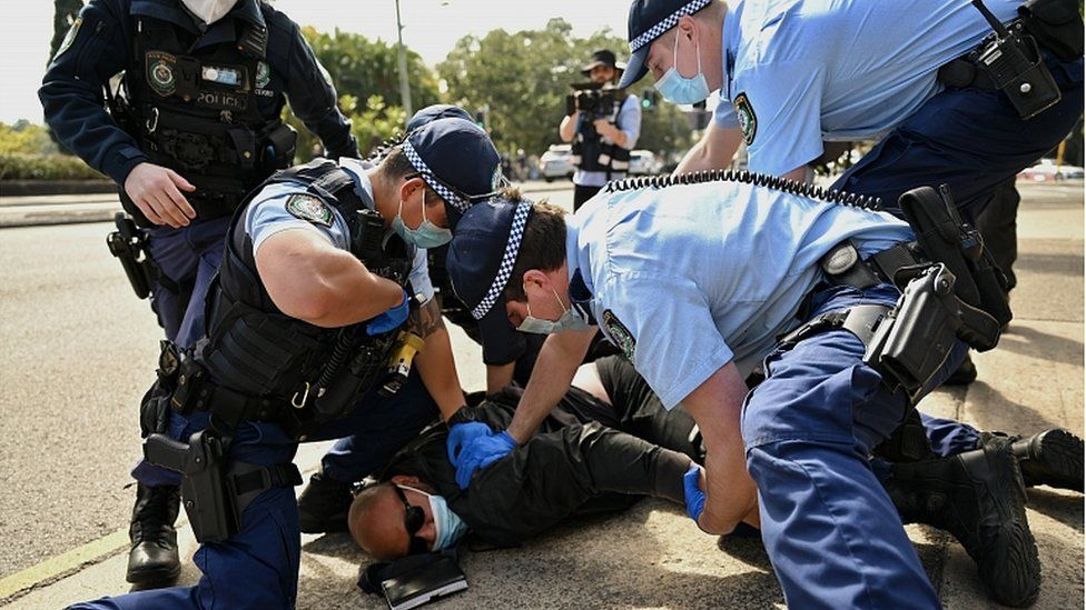 A protester is arrested by police in Sydney, Australia, 21 August 2021