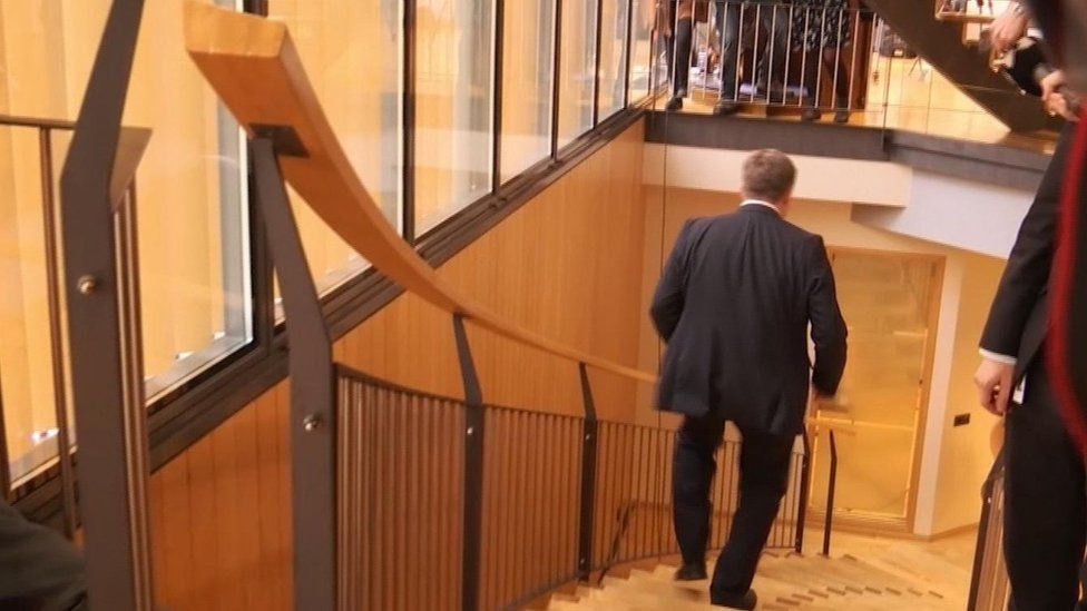 Screengrab taken from video showing Iceland's Prime Minister Sigmundur Gunnlaugsson walking down stairs after a meeting in parliament (5 April 2016)