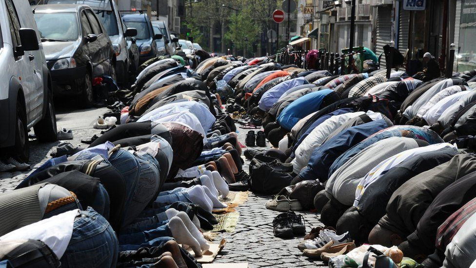 Muslims pray in the street as part of Friday's prayers on 8 April 2011 in Paris