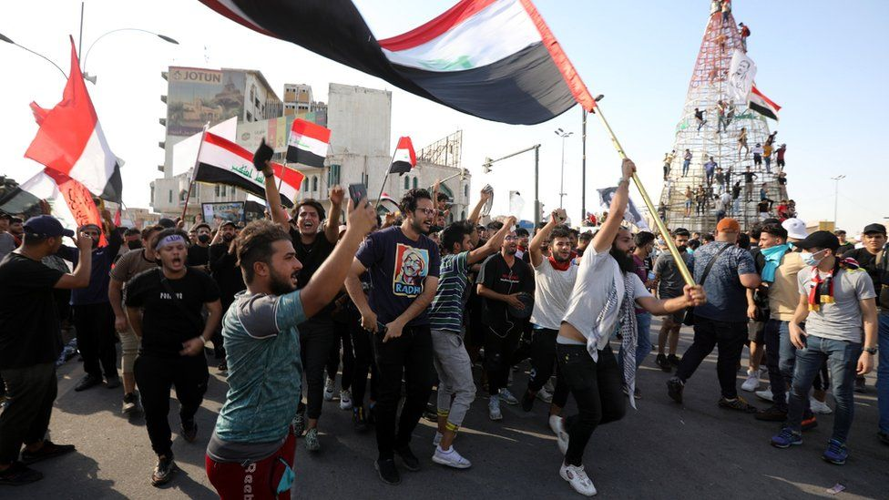 Demonstrators take part in an anti-government protest in Baghdad, Iraq (25 May 2021)