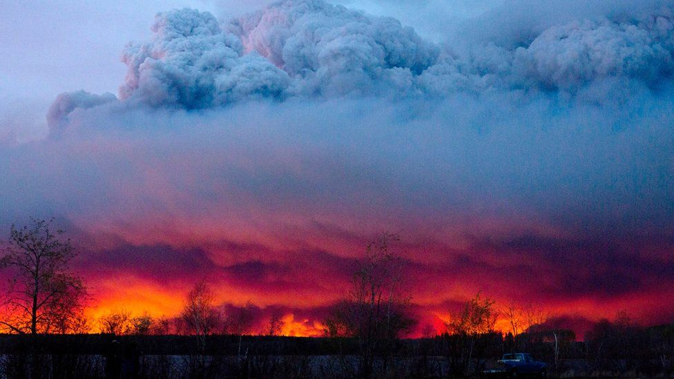 A wildfire moves towards the town of Anzac from Fort McMurray, Alberta., on Wednesday May 4, 2016