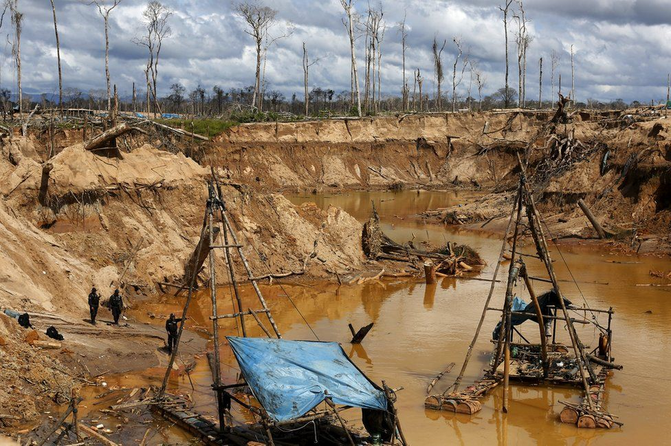 Peruvian police officers take part in an operation to destroy illegal gold mining camps in a zone known as Mega 14, in the southern Amazon region of Madre de Dios, Peru, 13 July 2015