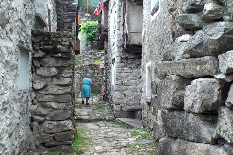 Old lady in a Corippo street