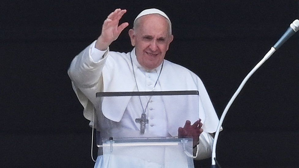 The Pope waves from the window of his study overlooking St Peter's Square at the Vatican on July 4, 2021