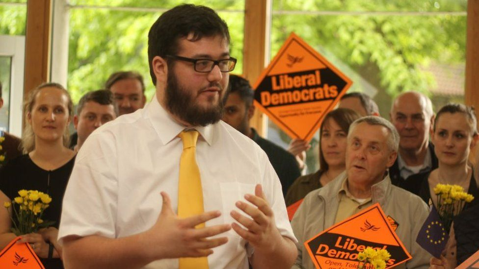 Will Dyer speaking to a group of Lib Dem supporters