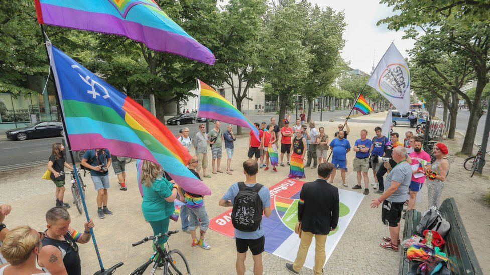 Followers of the QFC, Queer Football Fanclubs, community attend a gathering to remember the current situation of the LGBT, Lesbian, Gay, Bisexual, Transgender, people in Russia at the Russian embassy on June 10, 2018 in Berlin, Germany.