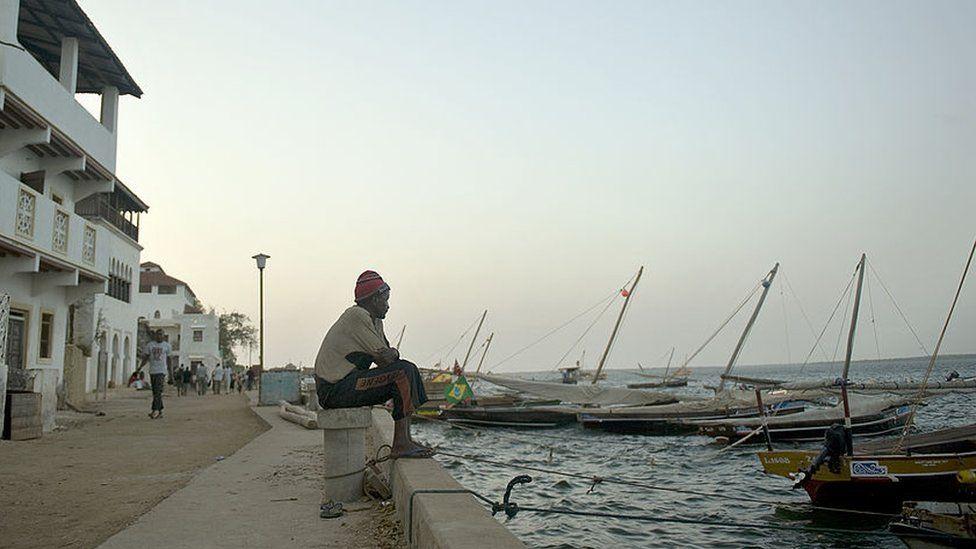 fisherman seated at a moor in Kenya's resort-island of Lamu, over 800 kilometres south-east of Nairobi