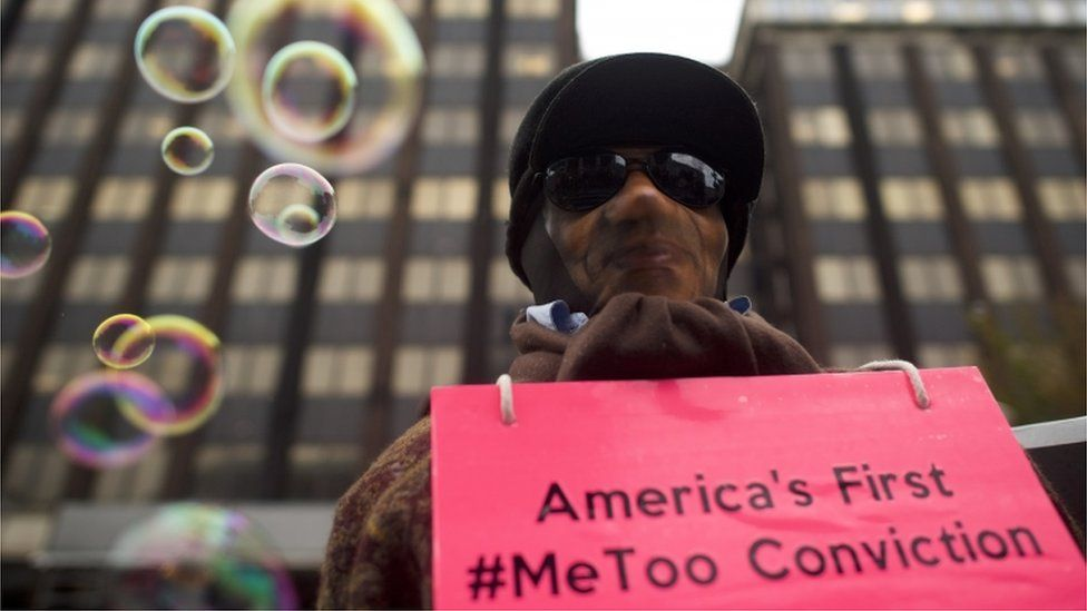 Protester holding sign saying America's First #MeToo Conviction